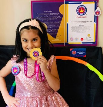 YOUNGEST KID TO PERFORM MOST HULA HOOP SPINS IN ONE MINUTE